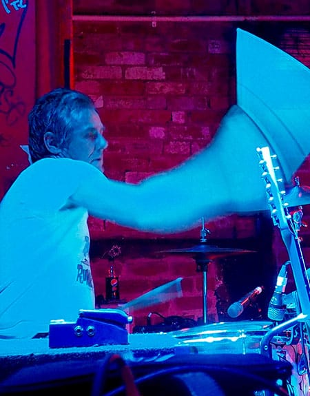 Ashley Davies, drumming during a gig